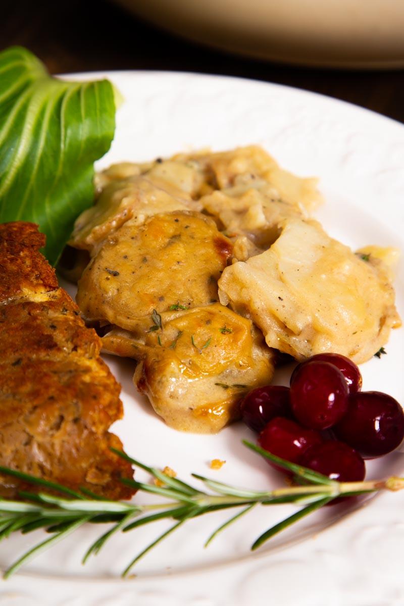 Vegan Potato Gratin, served with lentil loaf and cranberries.