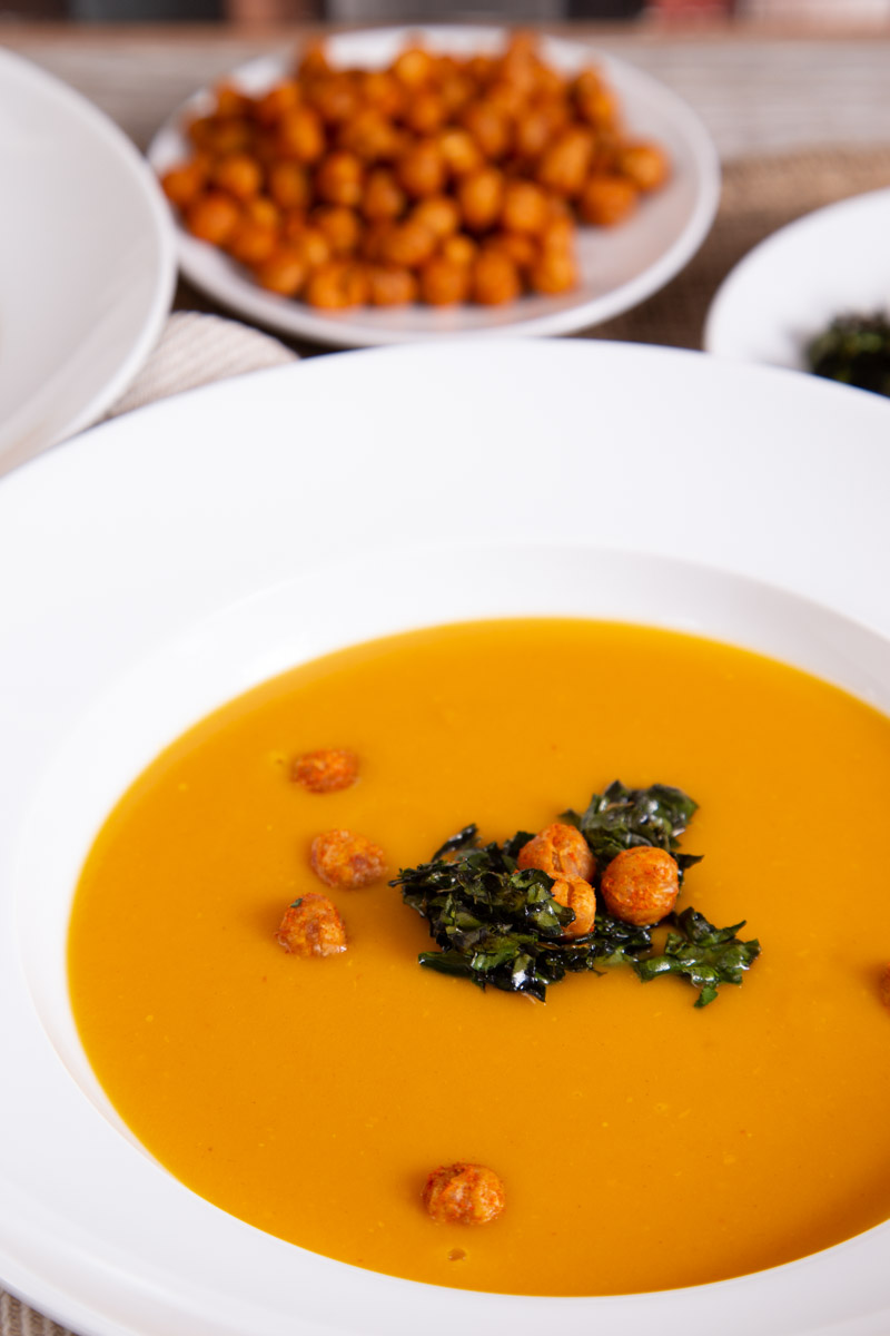 Winter Soup with Sweet Potato, topped with roast chickpeas and black kale.