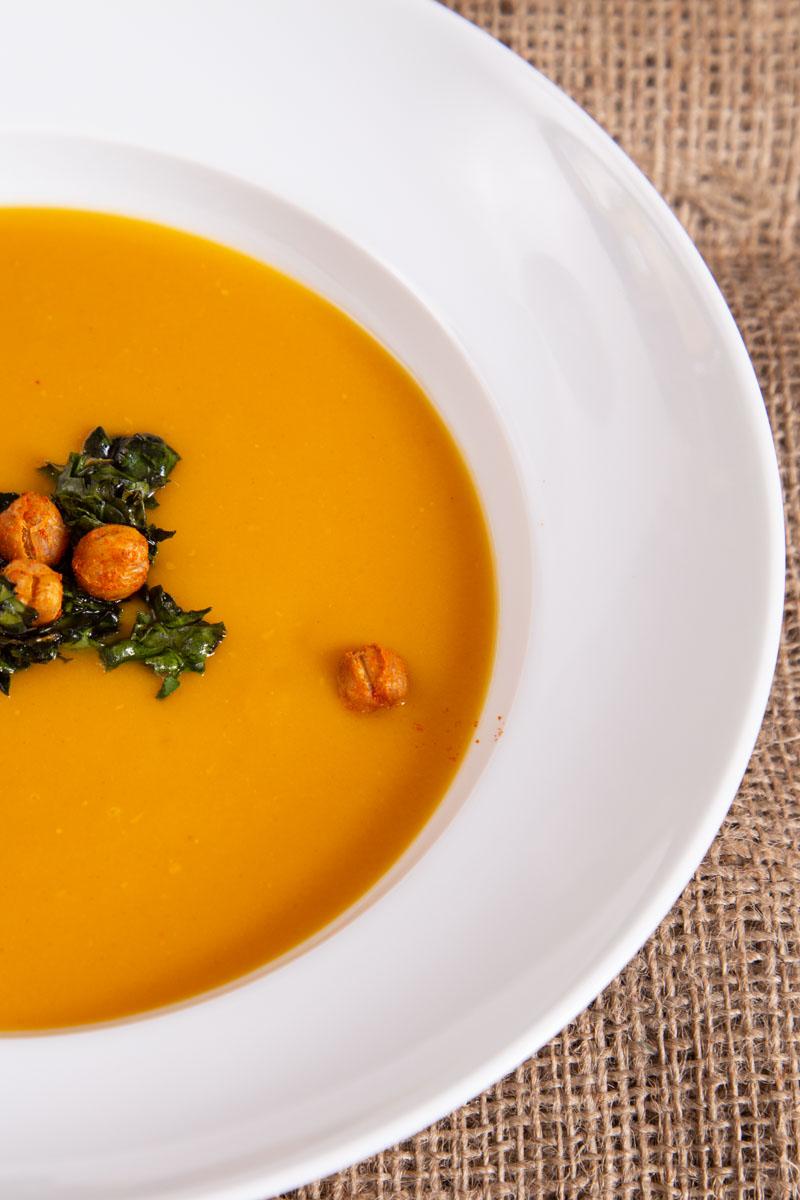 Spiced sweet potato soup on hessian sackcloth.