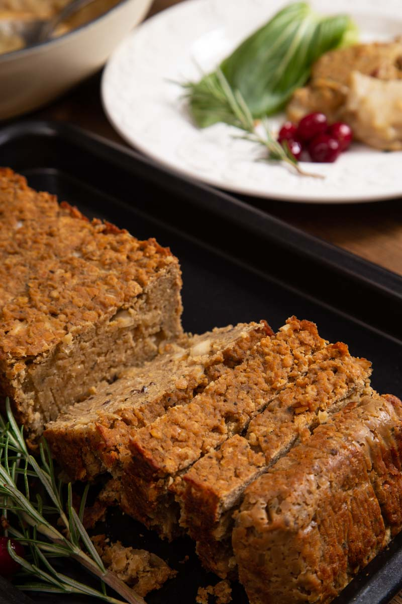Vegan Lentil Loaf with a sprig of rosemary.