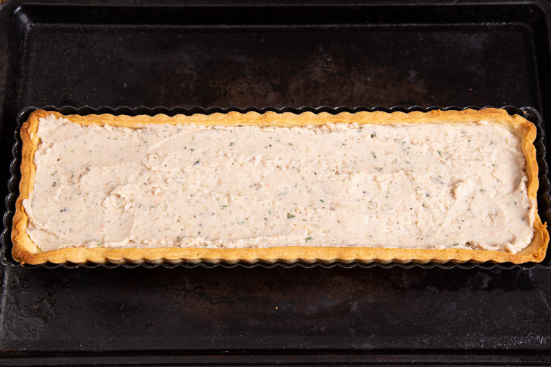 Vegan creamy white bean tart Filling with smoked garlic and thyme.