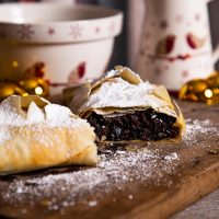 Christmas Pudding Strudel with Christmas crockery