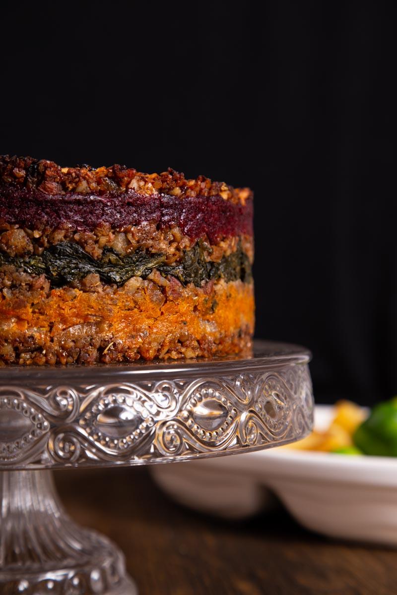 Vegan Centrepiece Roast on a glass stand.