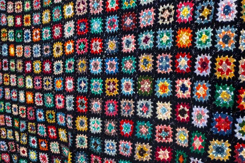 Vintage Granny Square Blanket on a washing line.