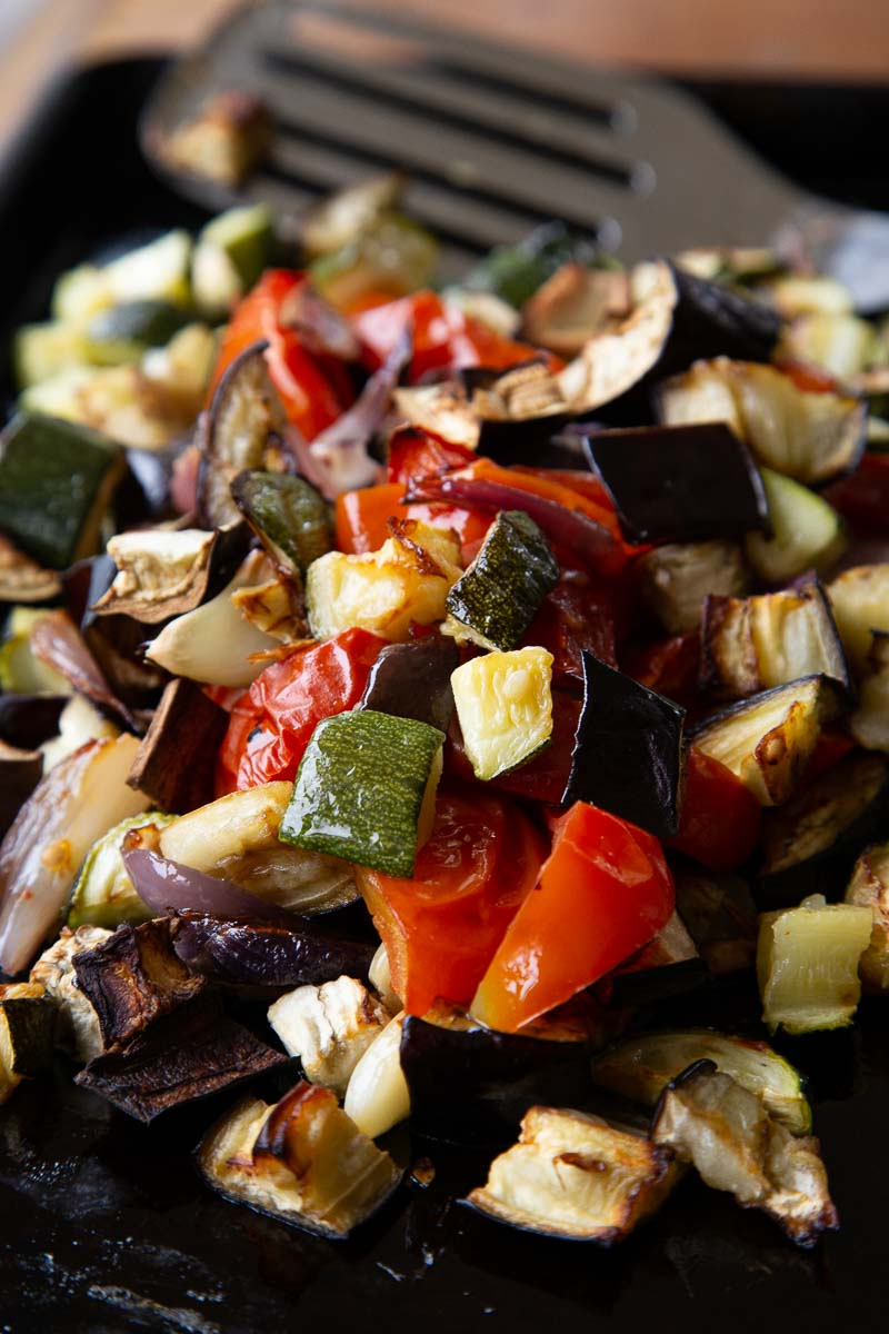 Roasted ratatouille vegetables on a baking tray.