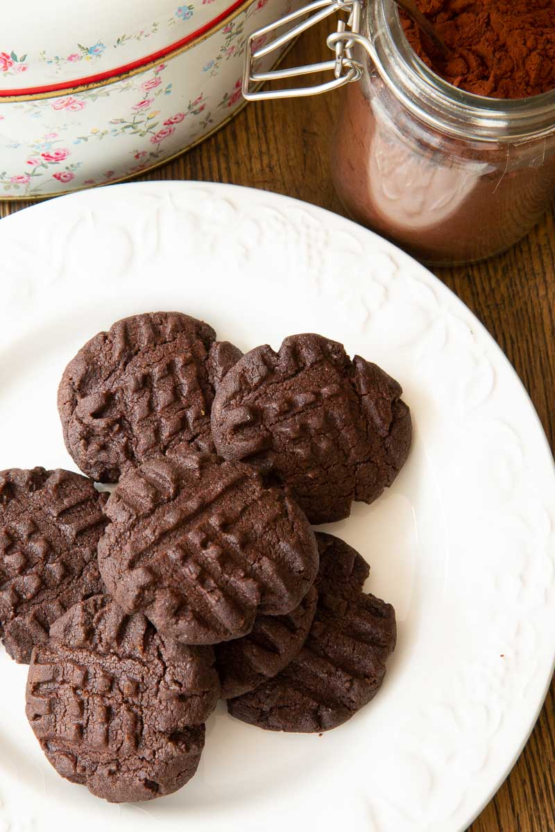 Chocolate Fork Biscuits on a white plate.