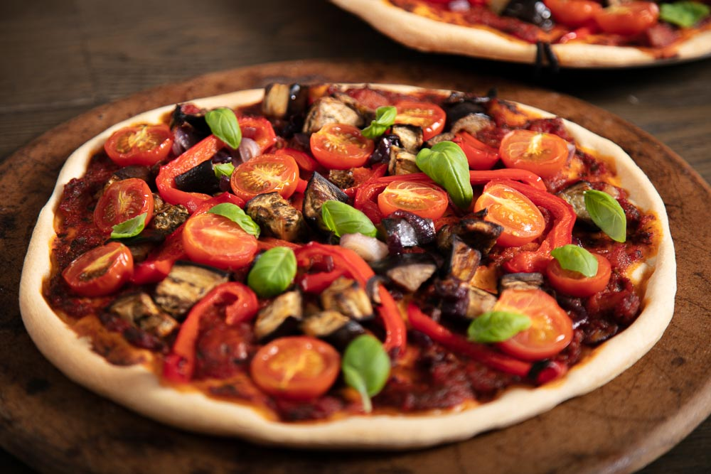 Roast Vegetable Pizza on a pizza stone.