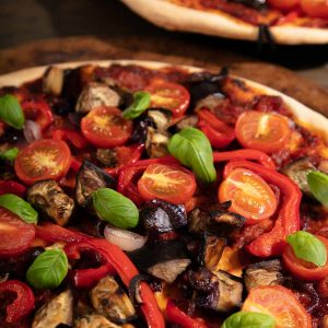 Roast Mediterranean Vegetable Pizza topped with basil leaves.