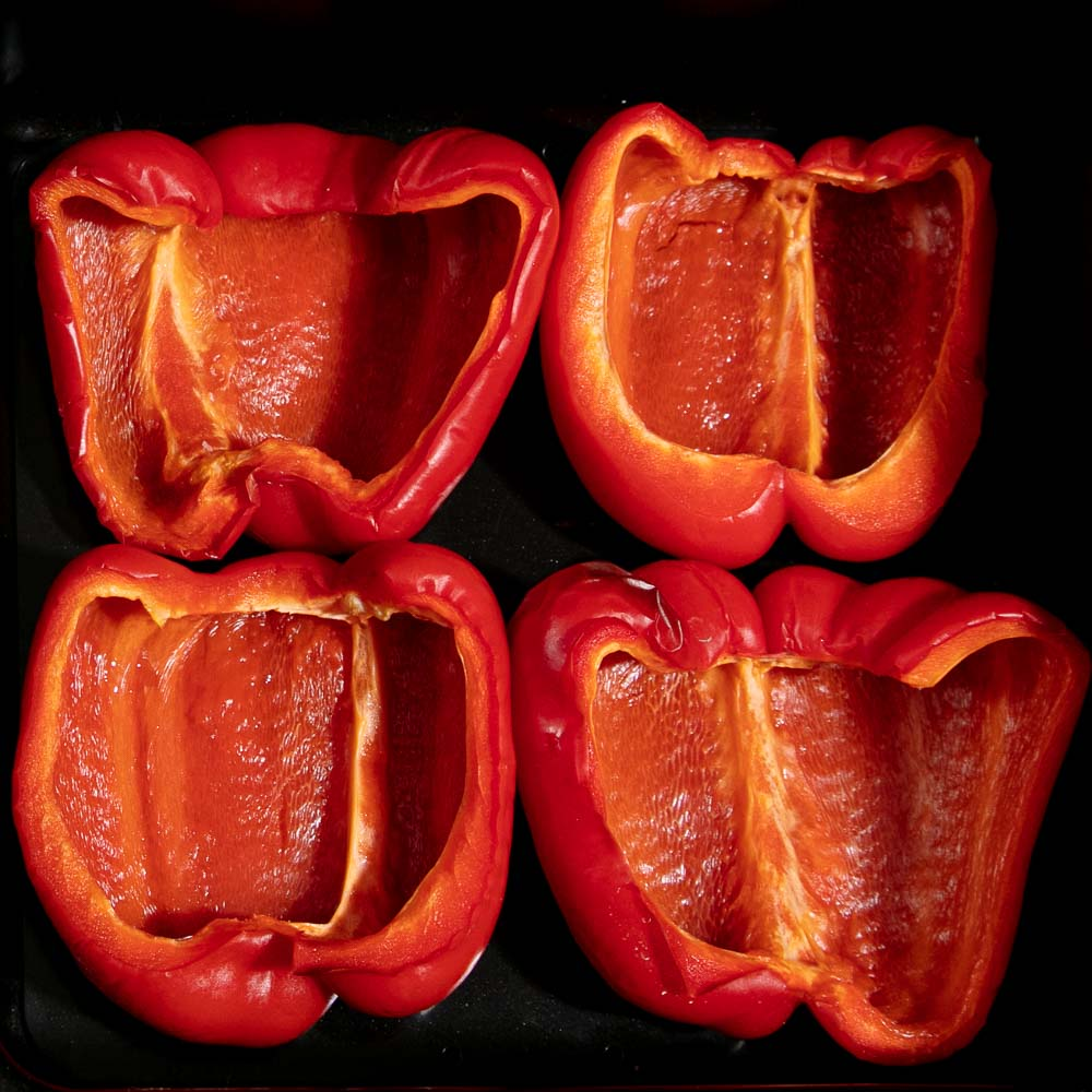 Four roasted red pepper halves.