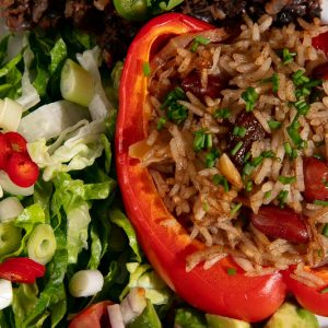 Rice stuffed bell pepper with nuts and a sprinkle of chopped chives.