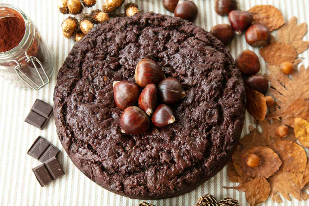 Chocolate Chestnut Cake topped with frash chestnuts in their shells.