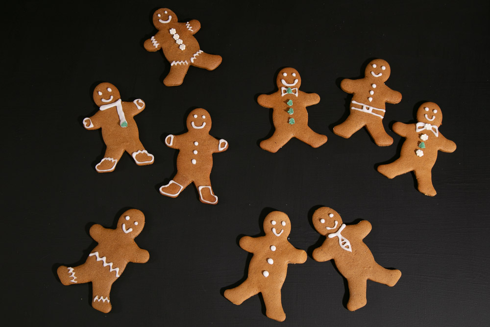 Vegan Gingerbread People decorated with glace icing clothes.