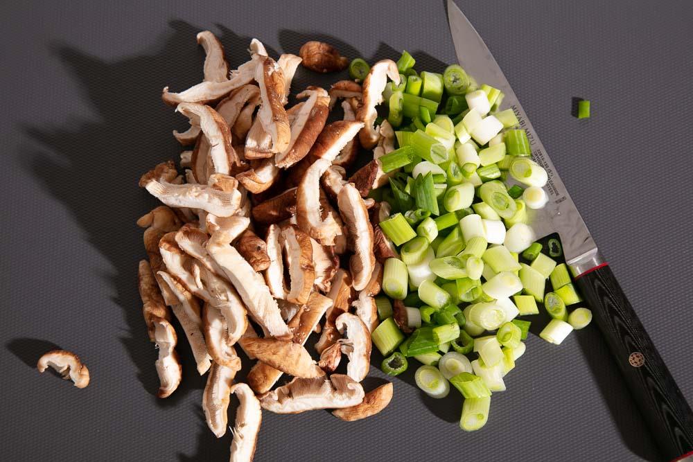 Chopped shiitake mushrooms and spring onions.