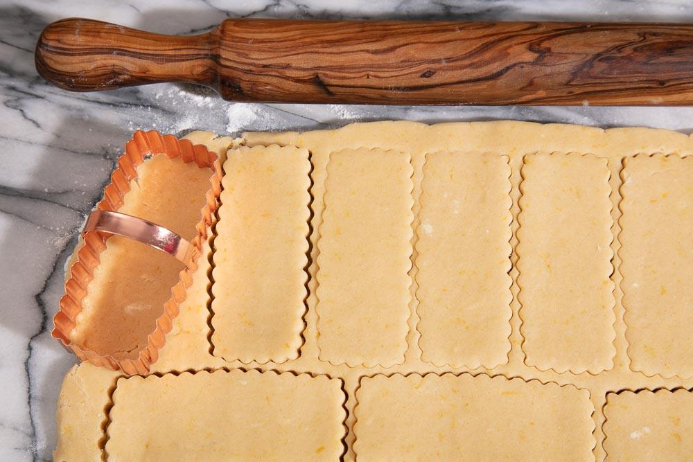 Vegan shortbread biscuit dough cut into shortbread finger shapes.
