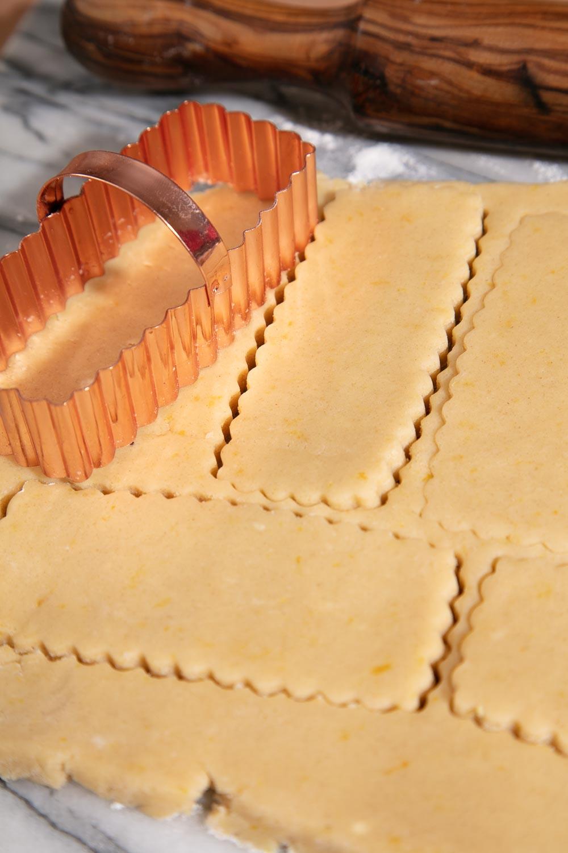 Speck of lemon zest in vegan shortbread biscuit dough.