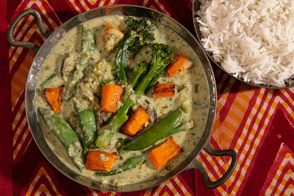 Butternut squash in a bowl of green curry.