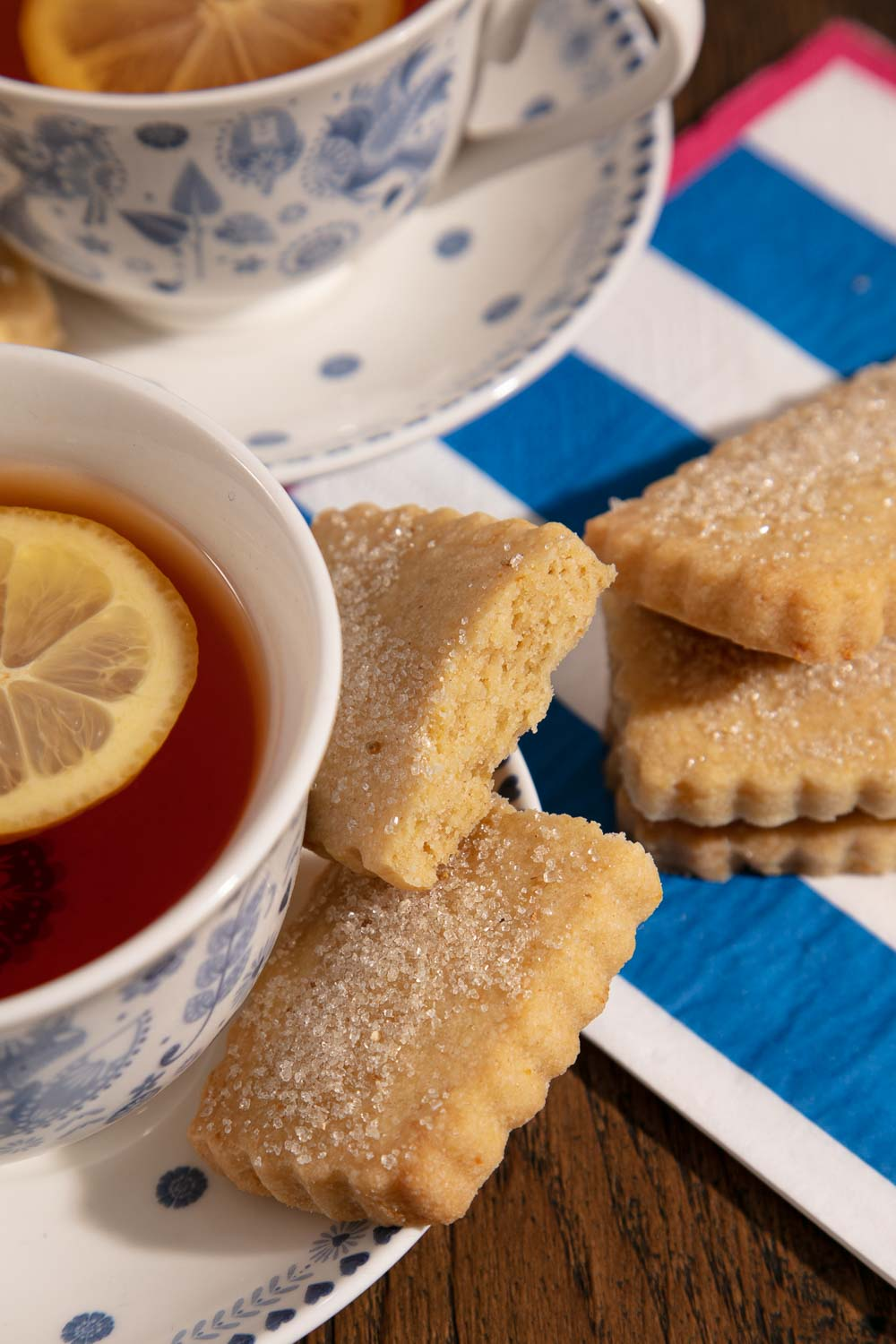 Earl Grey Tea with lemon and shortbread on blue and white striped napkins.