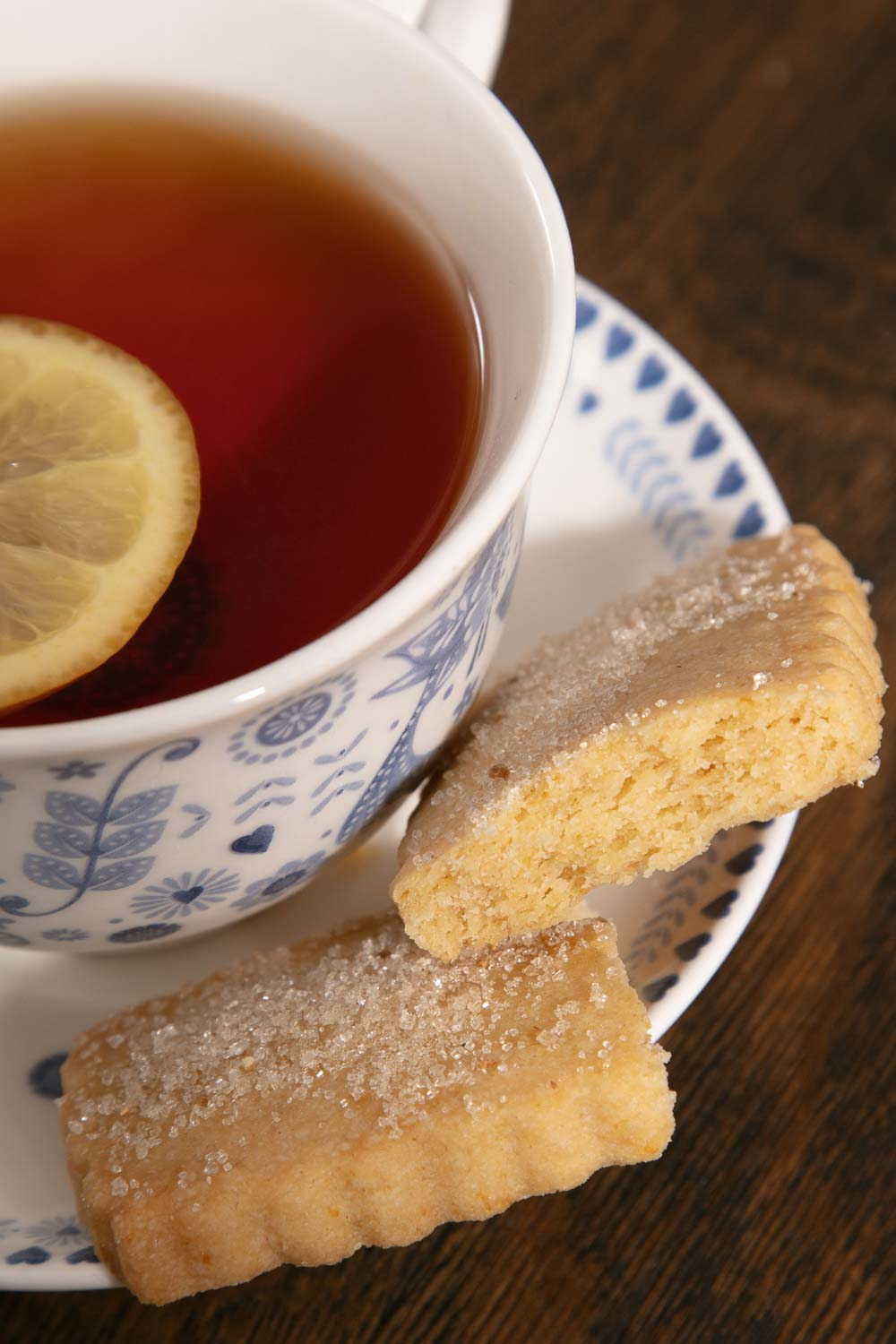 A piece of vegan shortbread with a cup of lemon and Earl Grey tea.