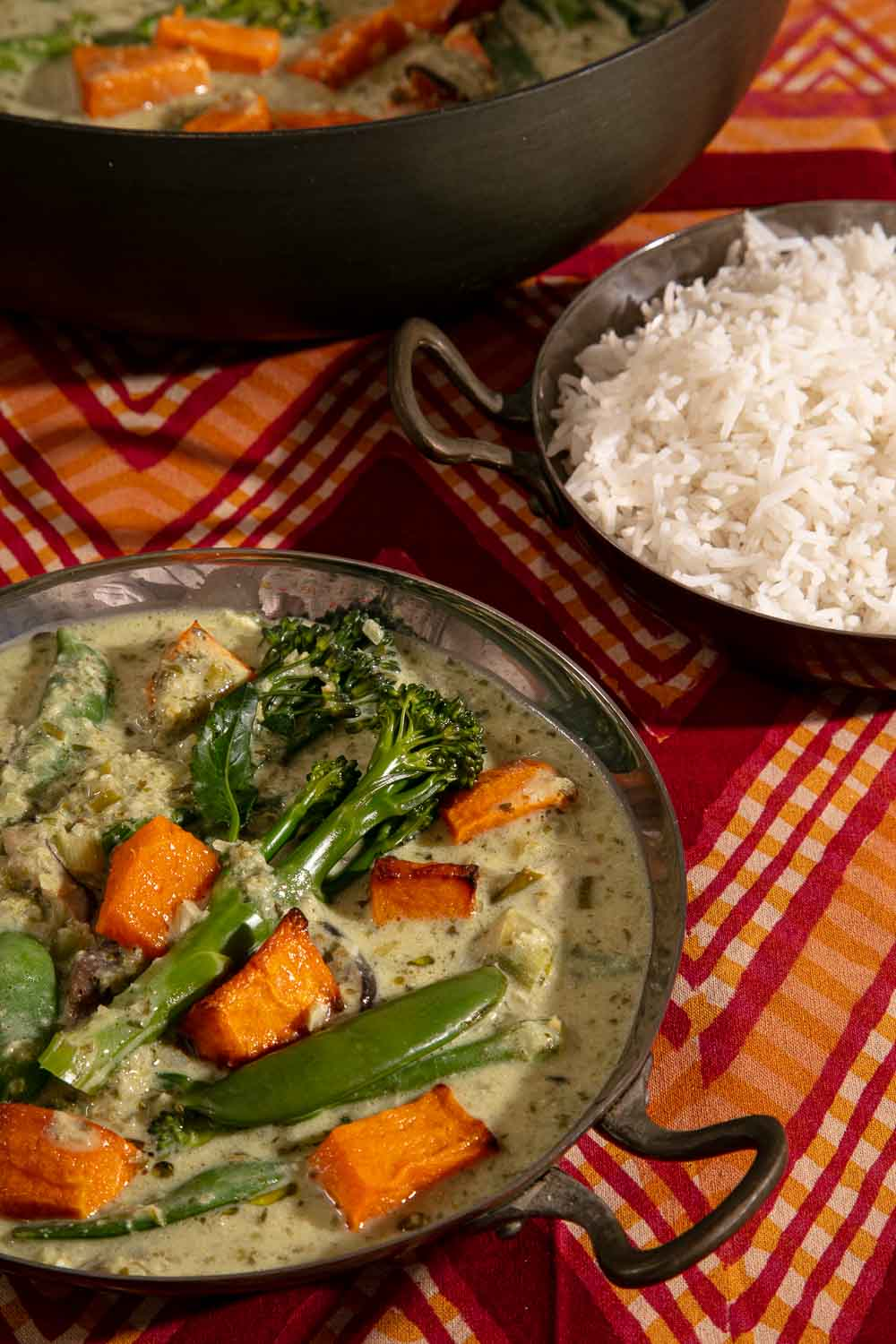 Vegan Thai Green Curry served with a bowl of rice.