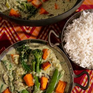 A bowl and pan of vegan Thai Green Curry and a bowl of rice.