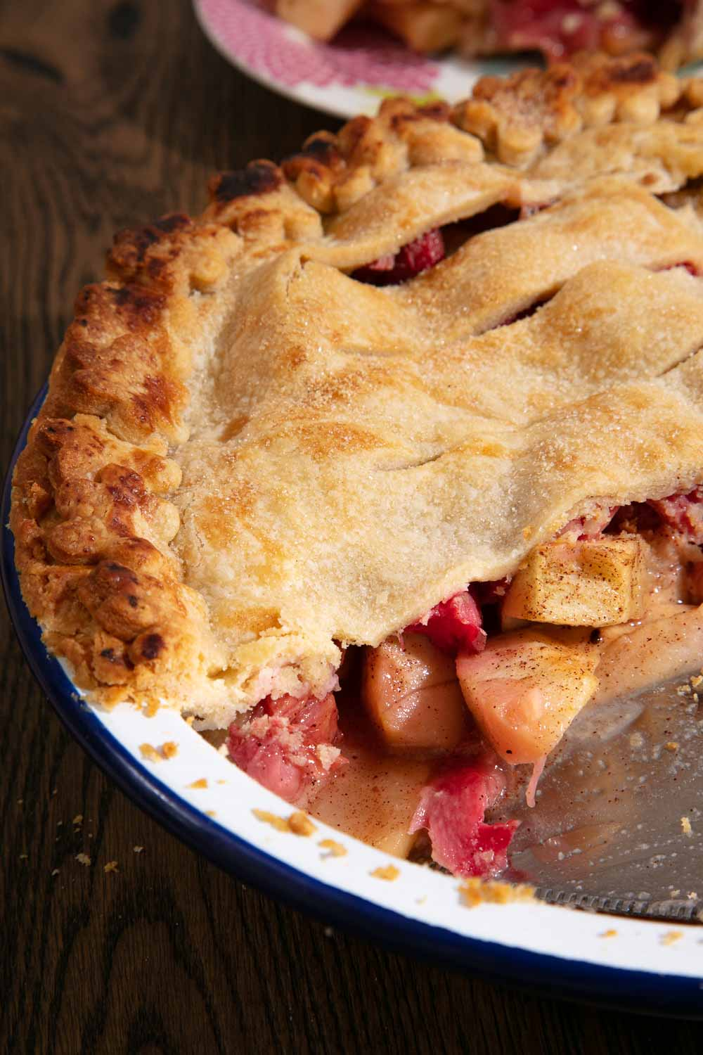 Apple and Rhubarb Pie cut to show the fruit inside.