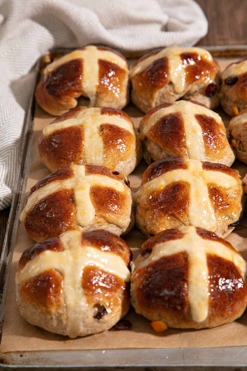 Vegan Hot Cross Buns, cooling on a wire rack.