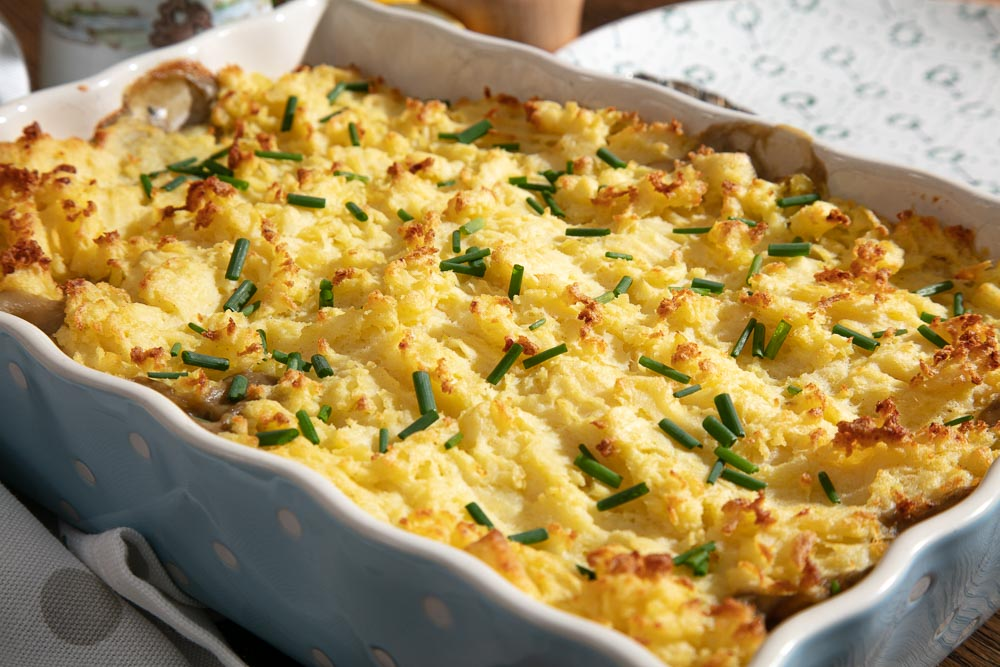 Browned mashed potato topping on vegan fish pie. Topped with snipped chives.