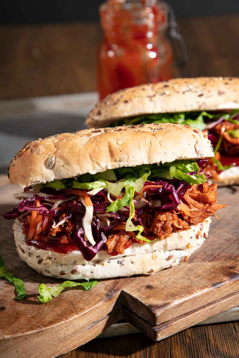 BBQ Jackfruit in a seeded bun with red cabbage coleslaw.