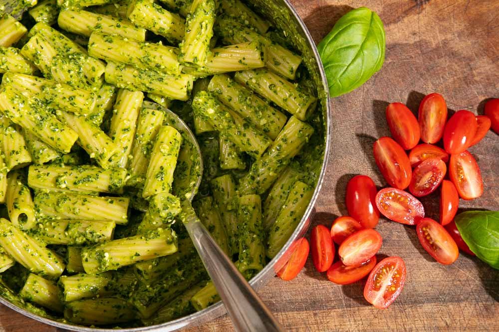 Pesto stirred into cooked pasta.
