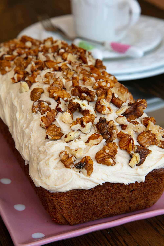 Vegan Coffee and Walnut Loaf Cake on a presentation plate.