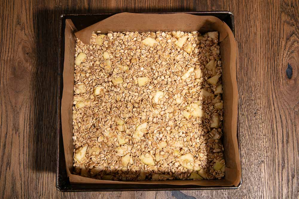 Apple flapjack mixture in a tin ready for the oven.