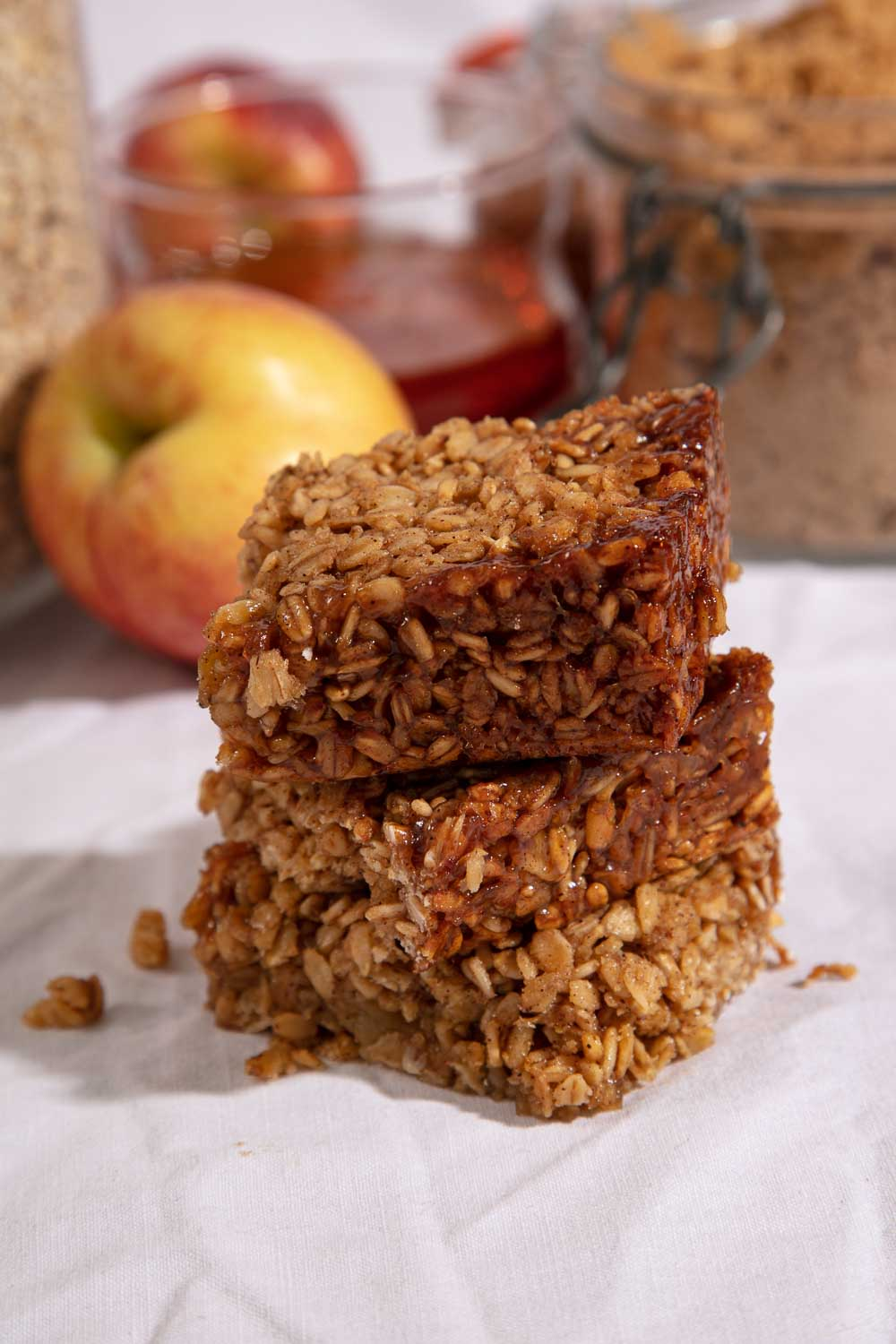 A stack of three slices of apple and cinnamon flapjack.